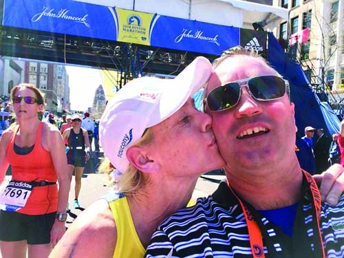 "Katy Kelly: Team MR8 marathoner Katy Kelly celebrated at the finish line with her husband Eddie Kelly. ""Love completely demolishes what the cowards attempted to try and do to us. This picture symbolizes that love perfectly."" 	Photo courtesy Katy Kelly"