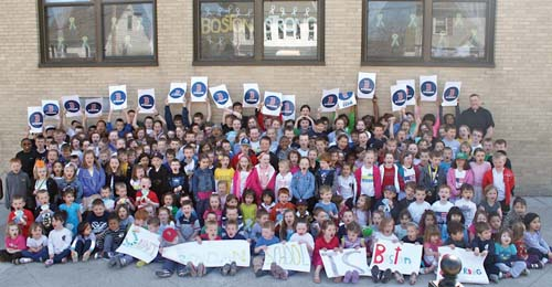 "The students of Saint Brendan School are pictured with Fr. John Connolly outside the school during their Boston Strong Dress Down Day on Friday April 26.  Students contributed money to be able to wear Boston Strong colors instead of their uniforms.  ""We raised over $2,300.00 which will be donated in its entirety to the Richard Family of Dorchester,"" said Maura Burke, the principal at St. Brendan School."