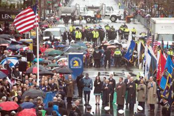 A flag-raising ceremony was held on Boylston Street on Tuesday afternoon. Among those on hand were the Richard family, former Mayor Tom Menino, Mayor Martin J. Walsh, Vice President Joseph Biden, Governor Deval Patrick, and BAA Director Tom Grilk. 	Photo: Jeremiah Robinson / Mayor's Office