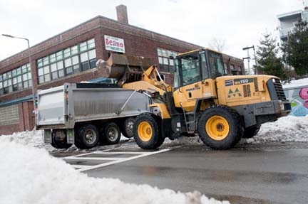 Snow removal in Uphams Corner: City workers clearing the way on Columbia Rd.