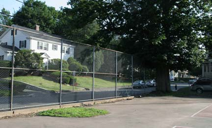 Savin Hill Tennis Court: The green at left along the fence is where the old oak tree once stood. Image courtesy Heidi Moesinger