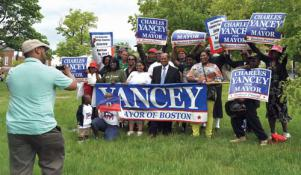 City Councillor Charles Yancey posed with supporters who joined him at the Haitian Unity Parade on Sunday. Yancey has submitted signatures to run for both Mayor and district four council. Bill Forry photo