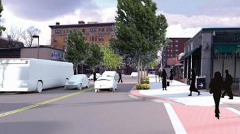 A rendering included in a draft report of the BRA's Fairmount Indigo Planning Initiative depicts improvements to the streetscape along Dudley Street looking west towards the Uphams Corner station. 	Image courtesy BRA