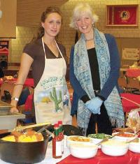 Claire Hughes, right, and friend at last year's Cookoff won by Lower Mills Civic.
