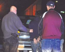 Prostitution crackdown: A suspect is arrested on Auckland Street during a Boston Police decoy operation on Friday, Oct. 12.