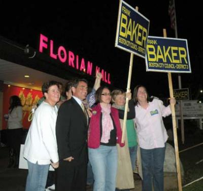 Councillor-elect: Frank Baker and his wife Today Baker posed for a photo with supporters outside Florian Hall shortly after the polls closed on Tuesday, Nov. 8. Photo by Pat Tarantino