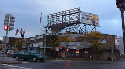 Billboard damaged in Adams Corner: Sandy's winds blew off an ad atop this building.