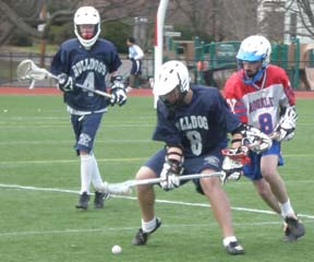 Bulldogs lacrosse, April 4, 2009: The Bulldogs fell to Brookline in their fourth outing of the '09 campaign. Above, Charlie Marshall and Kristian Kirleis fight for a loose ball.