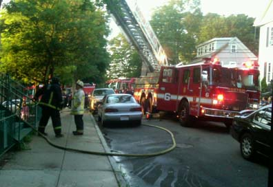 Butler Street apartment fire: The scene outside 68 Butler Street this morning. Photo by Ryan Whitcomb