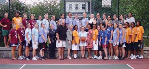 Competitors in Maureen Feeney's Women's Basketball League, which rules the court on Monday nights at Hemenway Park, smile for the camera along with members of Dorchester's political delegation. City Councillors Steve Murphy and Maureen Feeney and State Re