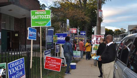 Chittick School on Mattapan-Hyde Park line: This voting station in Ward 18 can be a powerhouse double-precinct— and often is on a big election day. That wasn't the case on Tuesday, where even the evening rush was muted. Above, poll workers wait for some action outside of the precinct doors.
