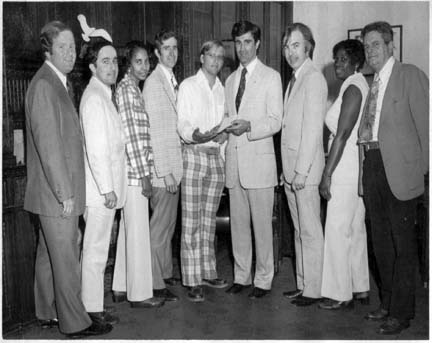 Codman Square Health Center Incorporated: April 1975 ceremony. Pictured, l-r, State Rep. W. Paul White, City Councillor Larry DiCara, Doris Brown, John MacNeil, Bill Walczak, Secretary of State Paul Guzzi, Craig Wall, Mona Scantlebury, and Charles Murphy.
