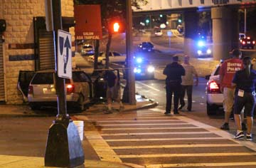 Deadly shooting on Columbia Road: Two people were shot to death in the car shown at left. Photo by Marcus DiPaola
