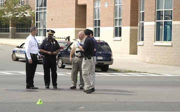 Shooting outside Lilla Frederick School: Investigators on the scene at Columbia Rd. and Wyola Place. Photo by Bill Forry