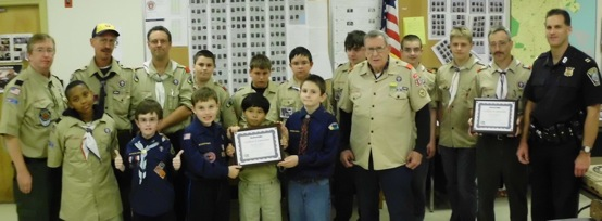 Scouts honor: C-11 police host Dot packs: Pictured top row: Mike Simmons, Pack 28 Committee Chairman, John Anderson Assistant Cub Scout leader, Chris Gross Assistant Boy Scout leader, Scout David Pelczar, Scout Brendan Brock, Scout Cameron Gross, Scout Robert Carney, Scout Alex Sorel, Scou