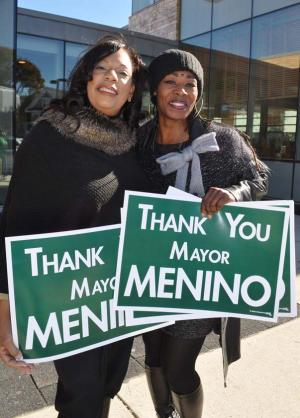 Deborah Smith-Pressley and Vanessa Wilson-Howard: Joined a stand-out to say farewell to mayor as his funeral procession passed on Blue Hill Avenue on Mon., Nov. 3. Photo by Bill Forry