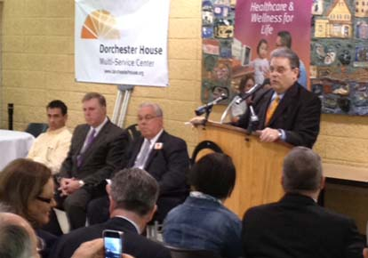 Dot House celebration: Dorchester House CEO Joel Abrams addressed a crowd at the facility this morning. At right, (l-r) are Councillor Frank Baker, Senator Jack Hart, Mayor Tom Menino. Photo by Ed Forry