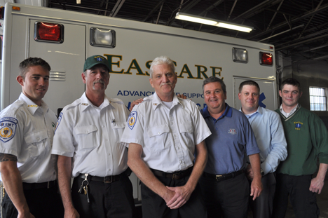 Eascare rescuers: Peter Todd, (center) an EMT dispatcher at Eascare Ambulance in Neponset is surrounded by some of the co-workers who saved his life in the moments following a severe heart attack last fall. Pictured left to right are George Stuart, Mark Donovan, Todd, CEO George Gilpin, Ryan Whitcomb and Dave Cavanagh.
