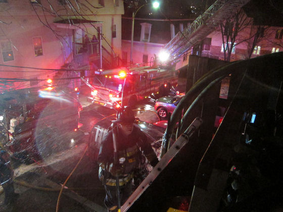 Firefighter at work on Everett Ave. Photo by Boston Fire Department