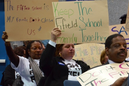 Fifield Parents Object to Closing: BPS Superintendent Carol Johnson's plan to close the school prompted these signs of protest at a Wednesday meeting in Jamaica Plain. Photo by Chris Lovett