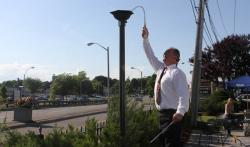 Freeport Tavern general manager Andrew Wilbur tests the torches on the restaurant's new patio area, which opened last night. Photo by Michael Caprio