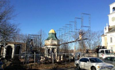 Progress at First Parish Church restoration project: Workers built a scaffold shelter around the steeple earlier this month.