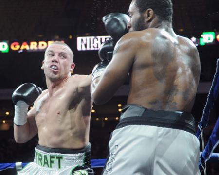 Still undefeated: Billy Traft lands one of his many punches on the face of Joe Powers on Saturday night at TD Garden. Photo by Emily Harney