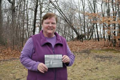 Dot Park Leader: Jane Boyer holds a photograph of her late mother, Jane Callahan Mullaney taken in Dorchester Park in the 1940s. It was taken near the present site of the tennis courts, where Boyer has organized annual Easter Egg hunts for children. Photo by Bill Forry