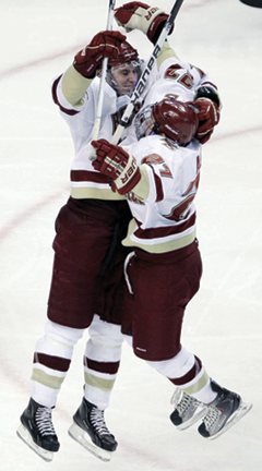 BC wins 2011 Beanpot : Jimmy Hayes celebrates his OT goal with teammate Patch Alber. AP photo