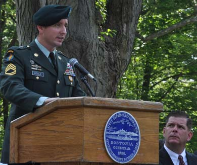 Lt. Greg Kelly: Dorchester native, a combat veteran of both Iraq and Afghanistan, spoke stirringly about the day's significance. Photo by Bill Forry