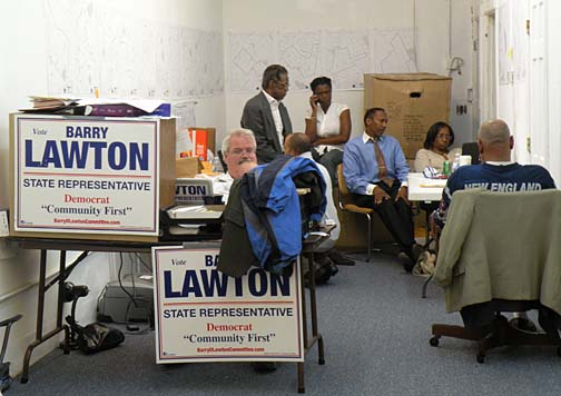 Lawton HQ on election night: The candidate, seated above center, monitored returns online. Photo by Pat Tarantino