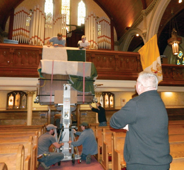 New organ gets a lift at St. Gregory's church. Photo by Bill Forry