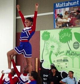 Mattahunt Center: Cheerleaders from Mattapan Pop Warner helped celebrate the center's re-opening last week. Photo by Alex Owens