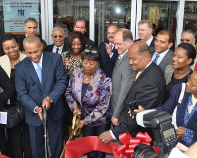 Mattapan Community Health Center ribbon cutting ceremony: Governor Deval Patrick, left, and Dr. Azzie Young, the president and CEO of the health center cut the ribbon this afternoon outside the new MCHC building at 1575 Blue Hill Ave. Photo by Bill Forry