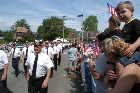 Memorial Day Parade: Members of the McKeon Post marched into Cedar Grove Cemetery during the 2006 parade. Photo by Bill Forry