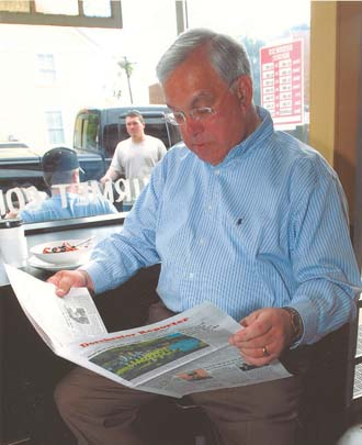 Mayor Menino reads the Reporter: Mayor Tom Menino gets his weekly dose of the Reporter at the Mud House, Neponset Ave., 2007. Photo courtesy Mayor's Office