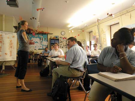 Members of the Boston Collegiate Charter School's eleventh grade talk cellular biology with teacher Meredith Leavitt.