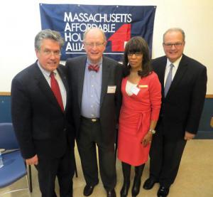 US Comptroller of the Currency Thomas Curry, left, with former Sovereign Bank vice president Thomas Kennedy, Bonita M. Irving, district community affairs officer for the Comptroller of the Currency, and Andrew Calamare, a former state banking commissioner