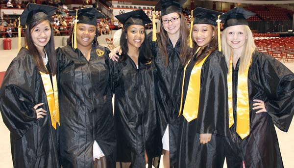 Latin Academy Grads: Members of Latin Academy's Class of '12 celebrated their graduations at  Northeastern University on June 10. From left, Nancy Tran (salutatorian), LaKiyah Russell (secretary), Leah Tavares (vice-president), Courney Bourque (president), Carliana Teixeira (treasurer) and Eda Kaceli (valedictorian).	Photo by Patrick O'Connor