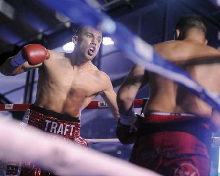 In this corner: Adams Corner's Billy Traft won his second professional bout on Sunday night at Gillette Stadium by knocking out opponent Dan Bonnell after one round. 	Photo by Emily Harney