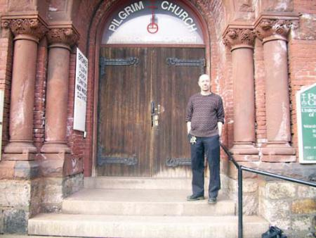 PILGRIM CHURCH: Rev. John Odams is shown on the steps of Columbia Road's Pilgrim Church, which serves as both a homeless shelter and food pantry as well as a place of worship. Photo by Tayla Holman