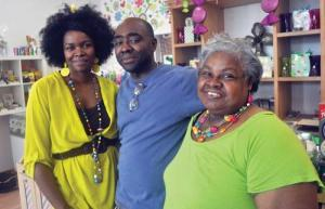 A Sweet Place: The owners of the new Fields Corner store A Sweet Life won an online contest and a visit from 'Cash Mob Dorchester' on Monday. From left, Beverly Hilaire, Edwin Hilaire, and Mae Riggs, Beverly's mom. 	Photo by Bill Forry
