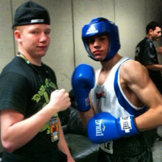 Marc Anthony Muniz, right, is pictured with trainer/coach Dan Kelly of Dorchester Boxing Club. Photo courtesy DBC