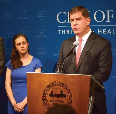 Mayor Martin Walsh convened a press conference on Monday to announce he would not sign a taxpayer guarantee for the proposed Boston 2024 Games without seeing the text of the agreement first. At left, he is joined by Sara Myerson, executive director of the Office of Olympic Planning.           	                                             Photo courtesy Mayor Walsh's press office.