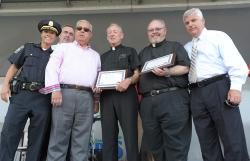 "Father Richard Conway and Father Jack Ahern accepted their award as ""Crime Fighters of the Year"" during National Night Out events at Moakley Park in South Boston last week. Pictured are BPD Deputy Superintendent Nora Baston, Commissioner Ed Davis, Mayor Menino, Fr. Conway, Fr. Ahern and Suffolk County District Attorney Dan Conley. Photo by Isabel Leon/Mayor's Office"