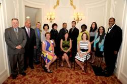 "Boston's Educators of the Year: (seated from left) Emily Bozeman, Brighton High School, Amy Gailunas, Dr. William W. Henderson Inclusion Elementary School, and Jayme Drzewinski, Thomas Edison K-8 School; Standing from left: Richard Stutman, Boston Teachers Union, Mayor Thomas Menino, Clifford Tetle, Oliver Wendell Holmes Elementary School, Dora Yu, Charlestown High School, Rosemary George White Henry Dearborn Middle School, Harry ""Chuck"" Gilliam, Richard J. Murphy K-8 School, Gregory Holt, Boston Arts Academy, Patricia Flakes, Madison Park Technical Vocational High School, Jennifer Muhammed, Joseph Hurley 2-Way Bilingual K-8 School, Superintendent Carol Johnson, and Rev. Gregory G. Groover Sr., Boston Public Schools Committee Chairman."