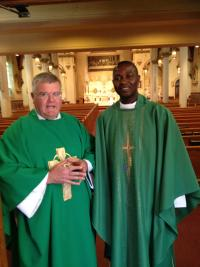 St. Gregory's pastor, Rev. Vincent Daily, and his Nigerian associate and friend, Rev. Peter Gengar. 	Bill Forry photo
