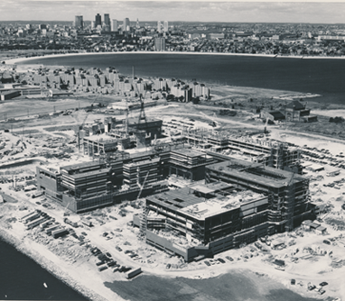 UMass Boston under construction: An aerial view of the UMass Boston campus under construction. The old Columbia Point housing development is visible just to the north of the campus. Image courtesy UMass Boston