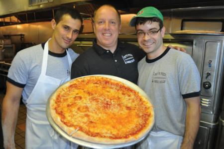 Pat's Pizza : Co-owner Pat Newell with employees Kleber Pintz, left and Vinnie Felix. Photo by Bill Forry