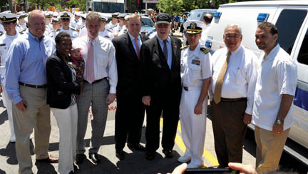 Dot Day 2011: (l-r) Council president Steve Murphy, Rep. Linda Dorcena Forry (with daughter Madeline), US Sen. Scott Brown, Sen. Jack Hart, Chief Marshal John Connor, Patrick Kulakowski, Commanding Officer of the USS Carr, Mayor Tom Menino, City Councillor Felix Arroyo